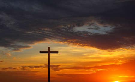 Christian cross over beautiful sunny sky panoramic view Stock Photo