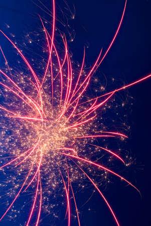 aerial bomb: Bright sparkling fireworks on blue sky background
