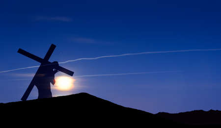 crucify: Christ carrying cross up Calvary on Good Friday over bright sky  Stock Photo