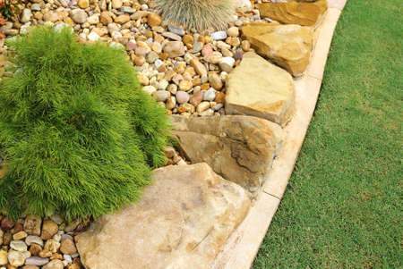Combinations of low-maintenance plants, rocks and grass