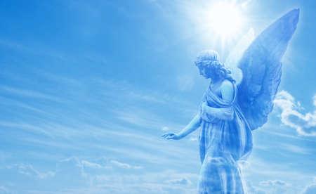 Beautiful angel in heaven with divine rays of sun light Standard-Bild