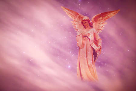 Beautiful angel in heaven with divine rays of sun light Banque d'images