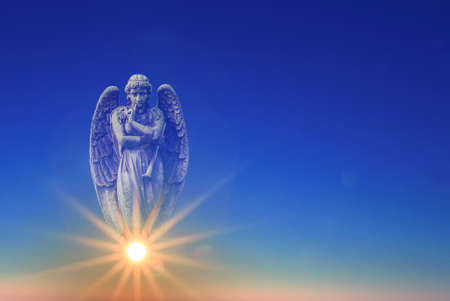 Beautiful angel in heaven with divine rays of sun light Stock Photo