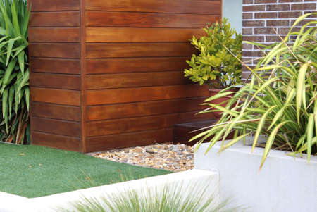 Combination of timber, plants, artificial grass, brick and wall Banque d'images