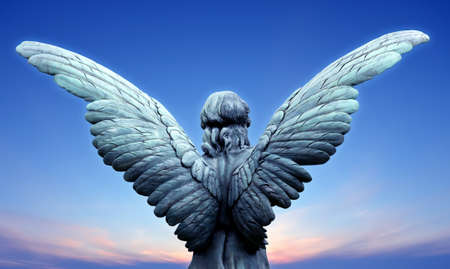 Beautiful angel on blue sky background with copy space Banque d'images