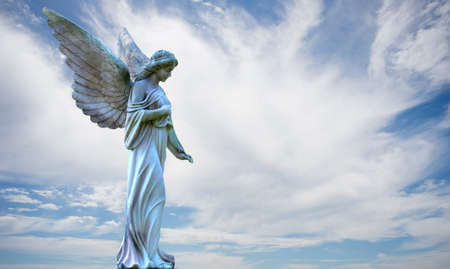 Beautiful angel on cloudy sky background with copy space