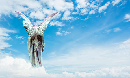 Guardian Angel in cloudy sky background panoramic view Banque d'images