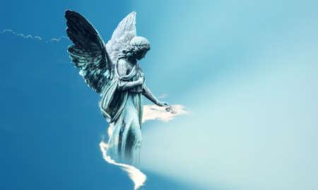 Beautiful angel in heaven with divine rays of sun light Zdjęcie Seryjne