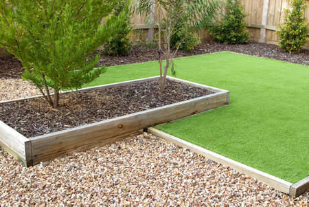 Combination of timber, plants, artificial grass, decorative gravel and mulch Banque d'images - 144041000