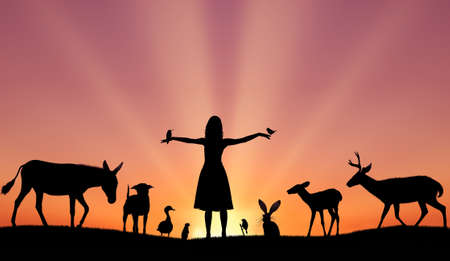 Silhouettes of girl and animals concept of harmony and uniting of wildlife and people Stock Photo