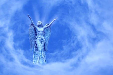 Angel over bright sky background concept of Religion Reklamní fotografie