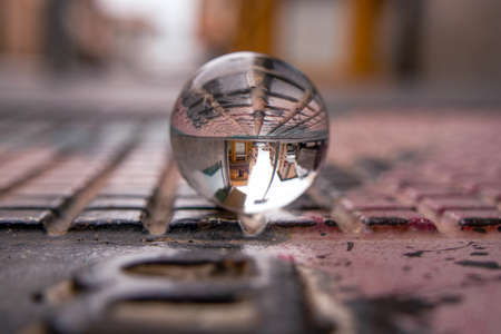 Crystal ball on the street, abstract reflections from the street