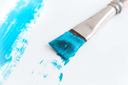 Brush that draws a blue line on a white background