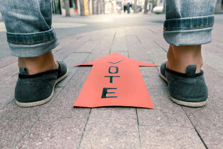 Symbolism with the election of politicians, an arrow with the inscription vote and feet