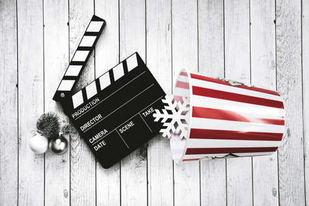 Clapper board, popcorn bowl and snowflake, movie composition