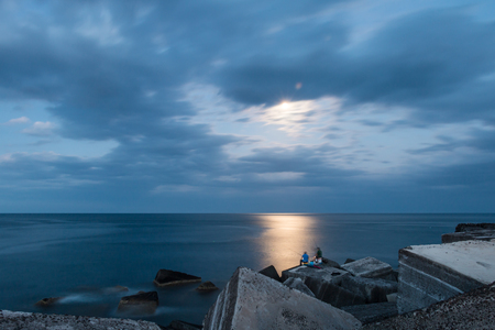 Fishing in the moonlight photo