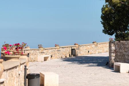 Narrow street with stone wall photo