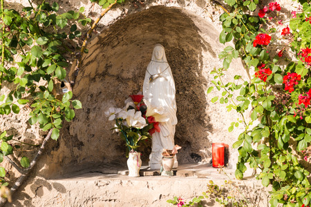 Statue of the Virgin Mary in the cave photo