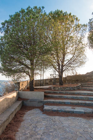 life after death: Cross between trees on a hill with stairs