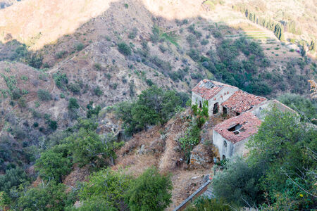Ruins of old houses in a small Sicilian village near Taormina photo