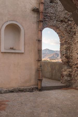 Ancient stone window That shows part of landscape
