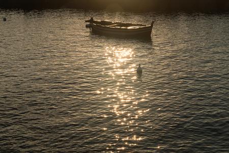 woden: Woden boat at sunrise after fisherman come back
