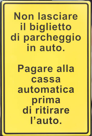 imperfections: Metal sign with directions and instructions in Italian