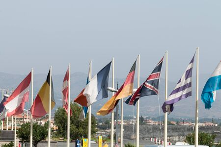 Group of flags representing the main European countries photo