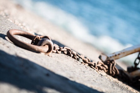 enchain: Rusty chains for small fishing boats in Riposto