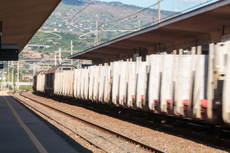 freight train: Freight train passing the station with fast loud whistle