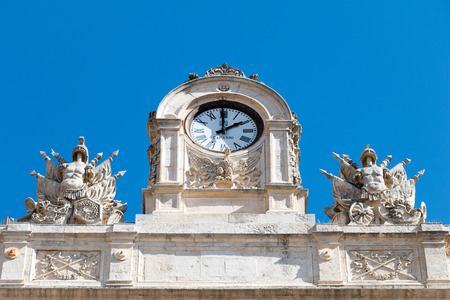 steps and staircases: City antique clock with two statues on the sides