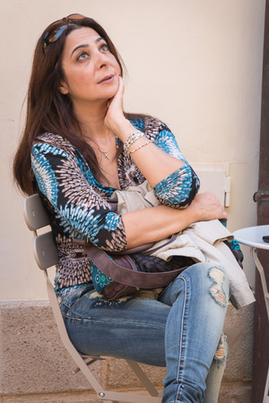 Woman waiting for coffe in Caltagirone Sicily photo
