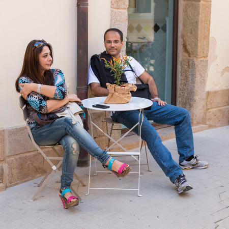 Couple waiting for coffe in Caltagirone Sicily photo