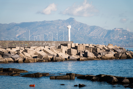 ionio: Port of Riposto with lighthouse and rocks protection