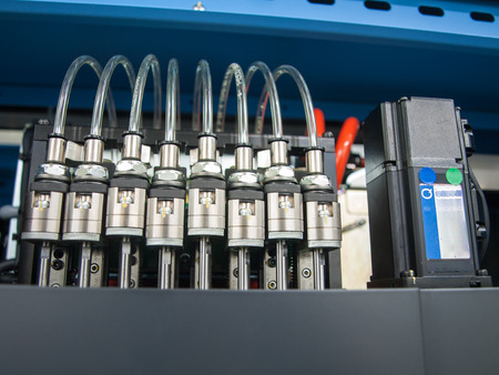 solenoid valves with transparent plastic pipes and motor Foto de archivo