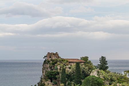 isola: Isola Bella Taormina in a cloudy day Stock Photo