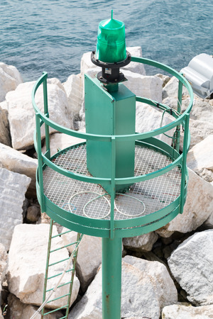 Signal Lamp near touristic harbour in Sicily