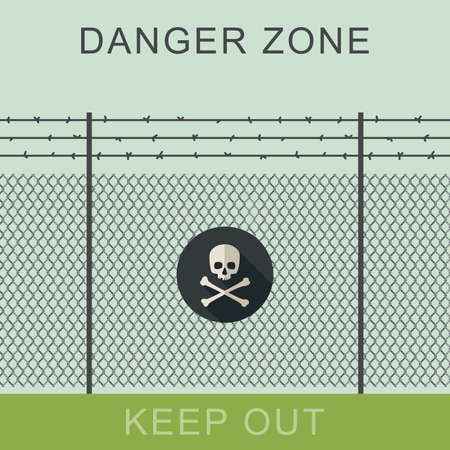 Danger zone with fence and sign of the skull bones.