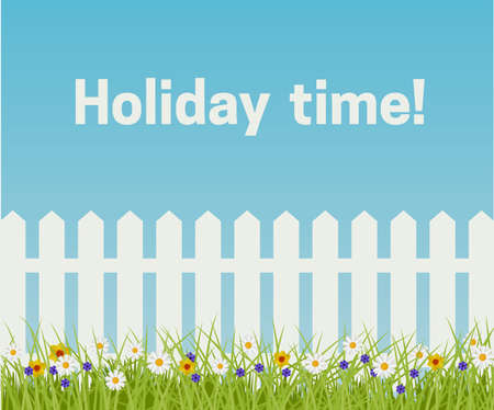 Grass and white fence on a blue sky background. Spring and Summer scene.
