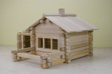 chain reaction: wooden house from the childrens designer Birch Stock Photo