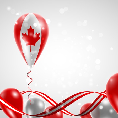 Flag of Canada on balloon. Celebration and gifts. Ribbon in the colors of the flag are twisted under the balloon. Independence Day. Balloons on the feast of the national day.