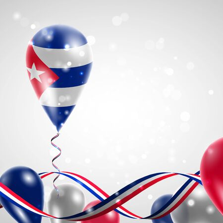 feast: Flag of Cuba on balloon. Celebration and gifts. Ribbon in the colors of the flag are twisted under the balloon. Independence Day. Balloons on the feast of the national day.