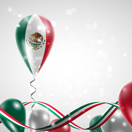 Flag of Mexico on balloon. Celebration and gifts. Ribbon in the colors of the flag are twisted under the balloon. Independence Day. Balloons on the feast of the national day.