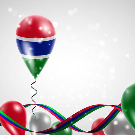 feast: Flag of Gambia on balloon. Celebration and gifts. Ribbon in the colors of the flag are twisted under the balloon. Independence Day. Balloons on the feast of the national day.