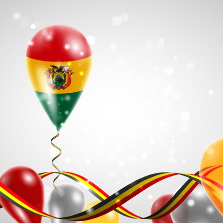 Flag of Bolivia on balloon. Celebration and gifts. Ribbon in the colors of the flag are twisted under the balloon. Independence Day. Balloons on the feast of the national day.