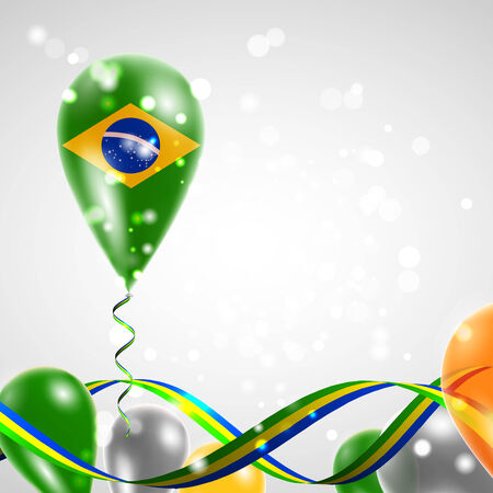 feast: Flag of Brazil on balloon. Celebration and gifts. Ribbon in the colors of the flag are twisted under the balloon. Independence Day. Balloons on the feast of the national day.
