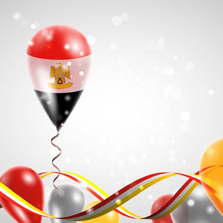 egypt revolution: Flag of Egypt on balloon. Celebration and gifts. Ribbon in the colors of the flag are twisted under the balloon. Independence Day. Balloons on the feast of the national day.