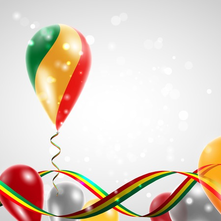feast day: Flag of the Republic of Congo on balloon. Celebration and gifts. Ribbon in the colors of the flag are twisted under the balloon. Independence Day. Balloons on the feast of the national day.