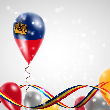 feast: Flag of Liechtenstein on balloon. Celebration and gifts. Ribbon in the colors of the flag are twisted under the balloon. Independence Day. Balloons on the feast of the national day.