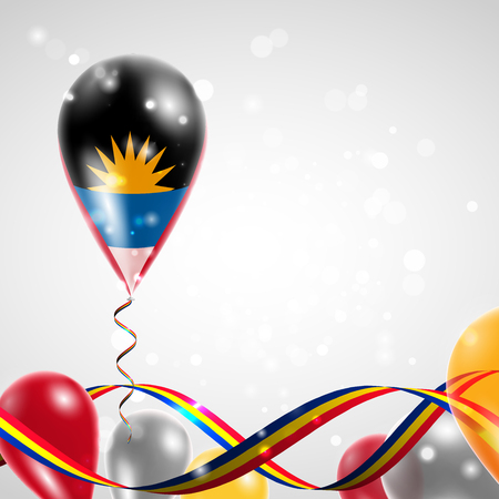 conquest: Flag of Antigua and Barbuda on balloon. Celebration and gifts. Ribbon in the colors of the flag are twisted under the balloon. Independence Day. Balloons on the feast of the national day.